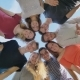 A Group of Friends of Students Look Down and Wave Their Hands - VideoHive Item for Sale