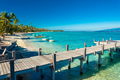 Little jetty and boat on tropical beach with amazing water, Moor - PhotoDune Item for Sale