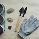 empty metal pot, gardening tools, gloves and seeds heaps - PhotoDune Item for Sale