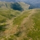 Aerial of Several Long Ranges with Speckled Areas in the Carpathians in Summer - VideoHive Item for Sale