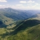 Aerial of Two Horizonless Carpathian Ranges with Dark Cloud Shades in Summer - VideoHive Item for Sale