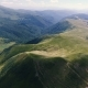 Aerial of a Multiformed Carpathian Range with Fuzzy Cloud Shades in Summer - VideoHive Item for Sale