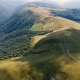 Aerial Shot of a Carpathian Range with a Snaky Country Road in Summer - VideoHive Item for Sale