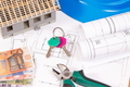 Currencies euro, home keys, electrical diagrams for engineer jobs and house under construction - PhotoDune Item for Sale