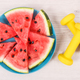 Fresh juicy watermelon and dumbbells, healthy lifestyles and dessert concept - PhotoDune Item for Sale