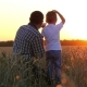 Happy Father and Child in a Wheat Field Watching the Sunset, Pointing Into the Distance - VideoHive Item for Sale
