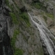 Tracking and Top Shot Air Shot From a Stream of Water Splashing Waterfall on a Rock Wall in the - VideoHive Item for Sale