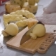 Cheese Maker Is Cutting Final Cheese Product on a Wooden Chopping Board on a Table,  of Hands - VideoHive Item for Sale