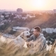 Young man and his labrador retriever at sunrise - PhotoDune Item for Sale