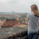 Slim Blonde Woman Is Admiring Panorama of Prague City View in Cloudy Windy Weather - VideoHive Item for Sale