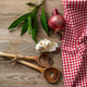 Wooden kitchen utensils, herbs and red tablecloth on wooden table, top view, copy space - PhotoDune Item for Sale