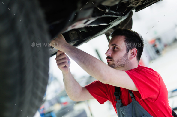 Car mechanic working at automotive service center - Stock Photo - Images
