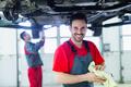Car mechanic working at automotive service center - PhotoDune Item for Sale