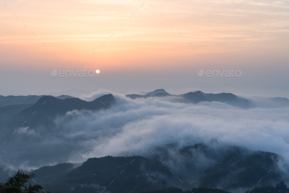 the sunrise and the sea of clouds at the top of the mountain - Stock Photo - Images