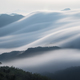 flowing clouds closeup on mountains - PhotoDune Item for Sale