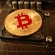 Gold Bit Coin BTC Coins on the Motherboard - VideoHive Item for Sale