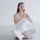 Young Woman Meditating in White Room - VideoHive Item for Sale