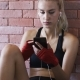 Sportswoman Listening To Music and Using Smartphone - VideoHive Item for Sale