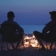 Two Friends of a Teenager Are Sitting By the Fire, Relaxing and Talking - VideoHive Item for Sale