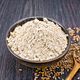 Flour linen in bowl with seeds in spoon on board - PhotoDune Item for Sale