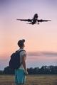 Traveler is looking at the landing airplane - PhotoDune Item for Sale