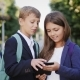 Two Schoolchildren Use a Tablet Outdoors - VideoHive Item for Sale