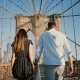 Romantic Couple Walk Along Brooklyn Bridge NYC, Hold Hands and Kiss on a Beautiful Summer Day, Back - VideoHive Item for Sale