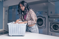 Young attractive woman in laundry - PhotoDune Item for Sale