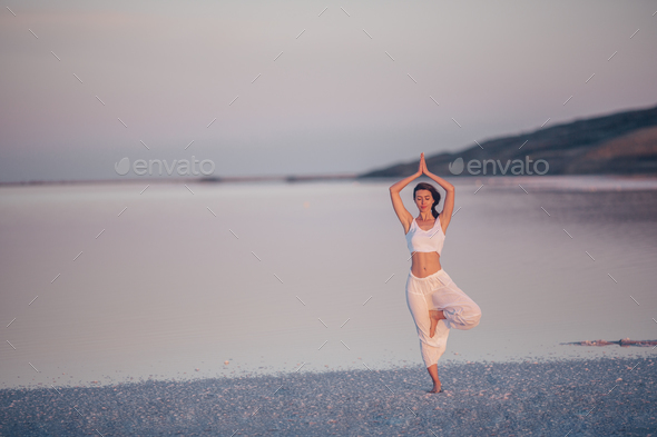 Young woman at sunset - Stock Photo - Images