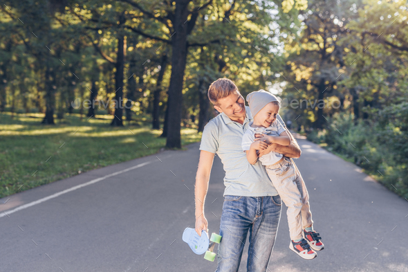 Happy father and son in the park - Stock Photo - Images