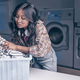 Attractive woman with a basket in laundry - PhotoDune Item for Sale