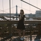 Happy Caucasian Girl Talking on Phone, Standing Near Amazing Brooklyn Bridge, New York View on a - VideoHive Item for Sale