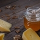 Cheese and Honey. Variety of Hard Cheese Is on Wooden Background. Honey on Honey Stick - VideoHive Item for Sale