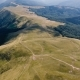 Aerial of a Boundless Carpathian Mountain Range with Curvy Lanes in Summer - VideoHive Item for Sale