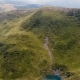 Aerial of a Carpathian Ravine with a Petite Pond and High Peaks in Summer - VideoHive Item for Sale