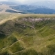 Aerial Shot of a Curvy Carpathian Range with a Craggy Ravine in Summer - VideoHive Item for Sale