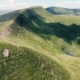 Aerial of a Small Pond at a Carpathian Mountain with a Sharp Crest in Summer - VideoHive Item for Sale