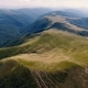 Aerial Shot of a Boundless Carpathian Mountain Range with Flat Tops in Summer - VideoHive Item for Sale
