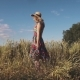 Carefree Young Woman Walking Through the Field in a Bright Dress and a Straw Hat - VideoHive Item for Sale