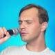 a Crazy Funny Young Man Sings Songs Into a Microphone. Color Background, . , - VideoHive Item for Sale