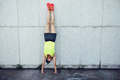 Woman doing a handstand leaning against wall - PhotoDune Item for Sale