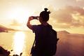 Woman taking photo with mobile phone on sunrise seaside - PhotoDune Item for Sale