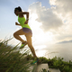 Woman runner running upstairs on seaside mountain trail - PhotoDune Item for Sale