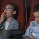 Little Girl Eating Popcorn in Movie Theater. Boy Using Smartphone at Cinema - VideoHive Item for Sale