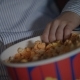 Child Hand Taking Popcorn From Paper Box at Cinema. Kids Take Caramel Popcorn - VideoHive Item for Sale