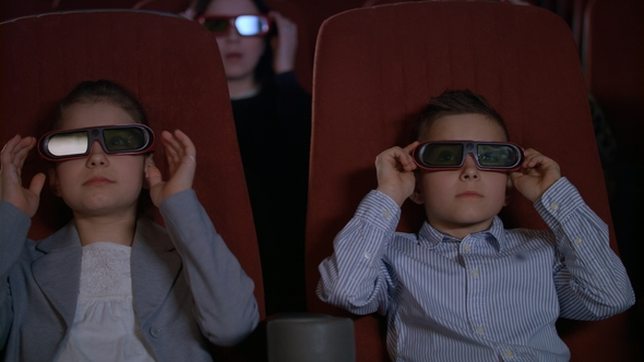 e097e97e66b Children Wearing 3d Glasses at Cinema Chair. Brother and Sister Watch 3d  Film (Stock Footage)