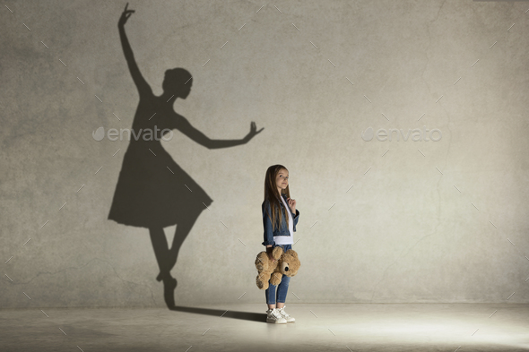 Baby girl dreaming a dancing ballet on the stage. Childhood concept. - Stock Photo - Images