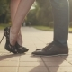 Woman Up Her Toe. Young Couple Stand at City and Kiss Each Other - VideoHive Item for Sale