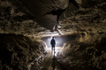 Man in cave with mysterious light - PhotoDune Item for Sale
