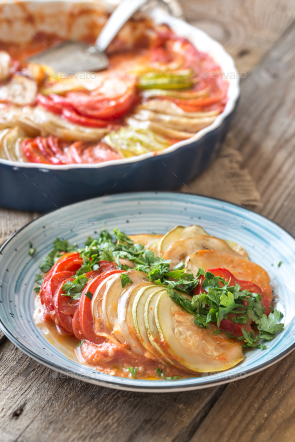 Dish of ratatouille on the wooden table - Stock Photo - Images